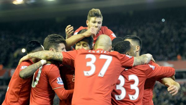 epa05047790 Liverpools James Milner (unseen) scores from the penalty spot to put Liverpool one up and then celebrates with his teamates during the English Premier League soccer match between Liverpool and  Swansea, Britain, 29 November 2015.  EPA/Peter
