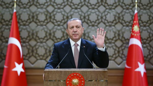 epa05042583 A handout picture provided by Turkish President Press office shows Turkish President Recep Tayyip Erdogan speaking during a meeting with village headmen, known as mukhtars, in Ankara, Turkey, 26 November 2015. Reports state Erdogan said Turkey