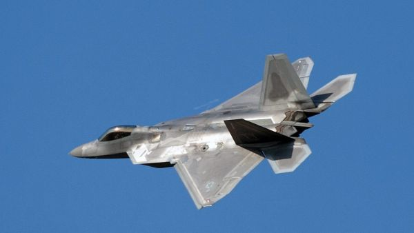epa04906359 A US Air Force jet-fighter F-22 Raptor aircraft in the sky at the 32 Tactical Air Base in Lask, Poland, 31 August 2015. Two US Airforce Lockheed Martin F-22 Raptor stealth tactical fighter aircrafts will take part in exercises with the new