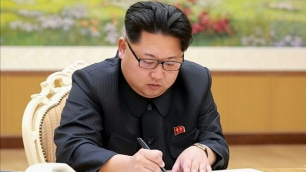 epa05089344 An undated photo published by the North Korean Central News Agency (KCNA) supplied by Yonhap News Agency (YNA) on 06 January 2016 shows North Korea's top leader Kim Jong-un sign an order for the country to conduct a hydrogen bomb test.