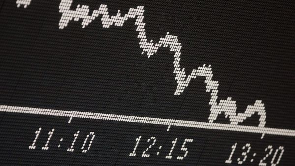 epa04108033 The graph of German stock index DAX points downwards around noon at the stock exchange in Frankfurt Main, Germany, 03 March 2014. Deepening fears about a war in Ukraine battered world markets Monday with shares in both Europe and Russia