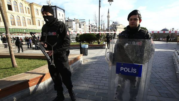 Policemen secure an area at the historic Sultanahmet district, which is popular with tourists, after an explosion in Istanbul, Tuesday, Jan. 12, 2016. The private Dogan news agency says at least two people were hospitalized following an explosion in the