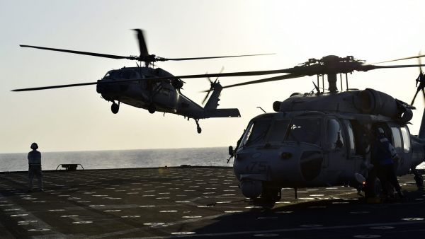 epa04475839 US Navy MH-60 helicopters conduct flight operations on board USS Ponce in the waters of the Persian Gulf, 03 November 2014. Coalition forces have begun on 2 November 2014 at-sea phase of the largest maritime counter-mine exercises of its kind