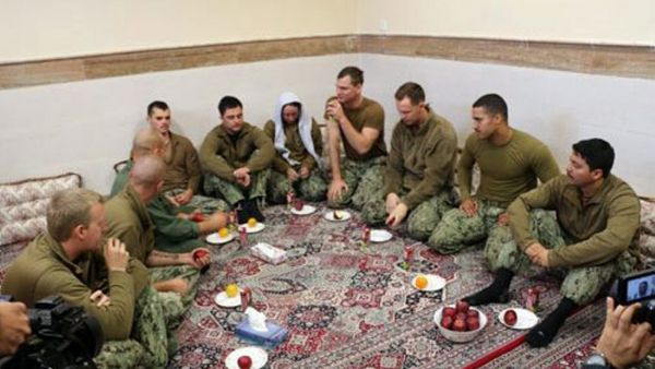 epa05100567 A handout picture made available by the official website of Iranian Revolutionary Guard Corps (IRGC) on 13 January 2016 shows US military personnel who were captured by the IRGC a day earlier, at an undisclosed location in Iran. Ten American