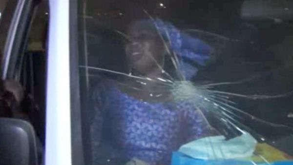In this image taken from video from AP Television, a rescued woman sits in a vehicle with bullet hole in windshield near the Splendid Hotel, Friday, Jan. 15, 2016, in Ouagadougou, Burkina Faso. The SITE Intelligence Group reports that an al-Qaida