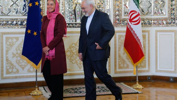 epa04996862 Iranian foreign minister Mohamad Javad Zarif welocmes and EU foreign policy chief Federica Mogherini  in Tehran, Iran, 28 July 2015. EU chief diplomat Federica Mogherini arrived in Iran on 28 July for a visit aimed at starting cooperation in