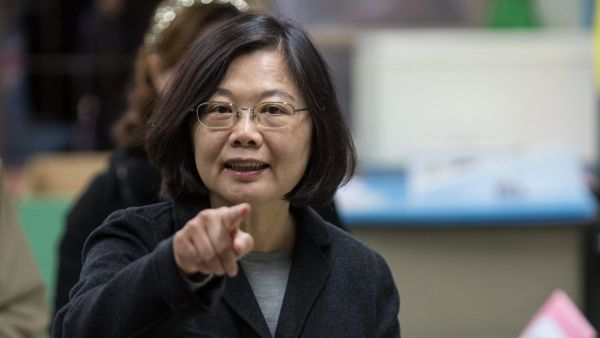 epa05104148 Chairwoman of the pro-independence Democratic Progressive Party (DPP) and presidential candidate Tsai Ing-wen gestures as she casts her vote in a school in New Taipei City, Taiwan, 16 January 2016. Several polls conducted last week suggest