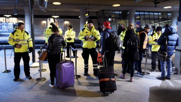 epa05087439 Security staff check IDs at Kastrups train station outside Copenhagen, Denmark, 04 January 2016. Identity checks went into effect for  travellers from Denmark to Sweden as part of measures to reduce the flow of migrants into Sweden. Passengers