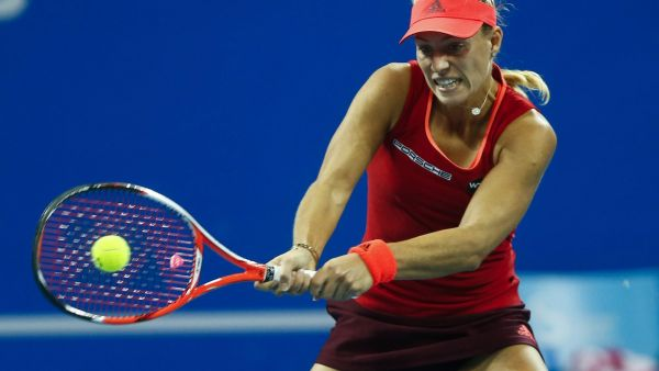 epa04967714 Angelique Kerber of Germany in action against Caroline Wozniacki of Denmark during their third round match in the China Open tennis tournament at the National Tennis Center in Beijing, China, 07 October 2015.  EPA/ROLEX DELA PENA
