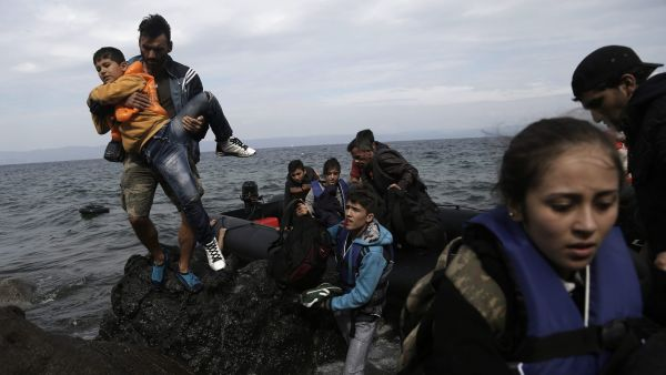 epa04968606 Refugees and migrants arrive at the island of Lesvos after crossing the Aegean see from Turkey, Greece, 08 October 2015. An estimated 100,000 refugees and migrants arrived on the Greek islands during August, according to the Hellenic Coast