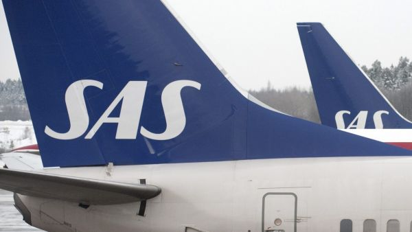 epa02516052 Scandinavian airlines SAS  and British Airlanes aircraft parked at the gates at terminal 5 at Arlanda airport, Stockholm   Jan. 04, 2011. Shares in Scandinavian airline SAS soared on January 4, 2011 after a report said carriers Air France-KLM,