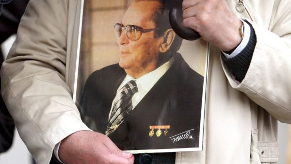 epa00702626 A man holds a picture of former Communist-era Yugoslav president Josip Broz Tito during a Labour Day protest rally in Sarajevo, Monday 01 May 2006. The protest organized by labour unions and several civic associations drew up to a thousand