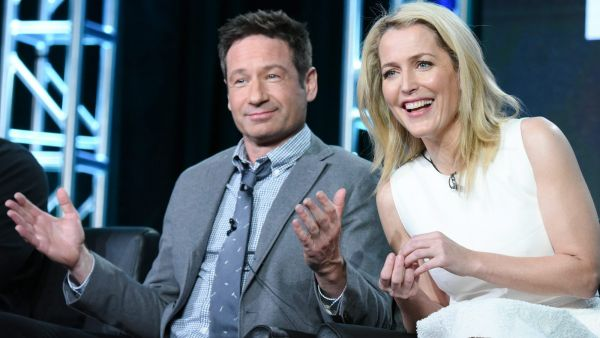 """Actors David Duchovny, left, and Gillian Anderson participate in """"The X Files"""" panel at the Fox Winter TCA on Friday, Jan. 15, 2016, Pasadena, Calif. (Photo by Richard Shotwell/Invision/AP)"""