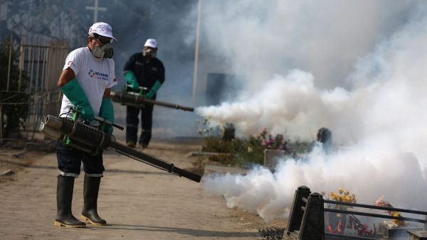Health workers fumigate to prevent Dengue, Chikunguya and Zika virus, at El Angel cemetery, in Lima, Peru, Wednesday, Jan 20, 2016. A U.S. warning urging pregnant women to avoid travel to Latin American countries where the mosquito-borne virus is