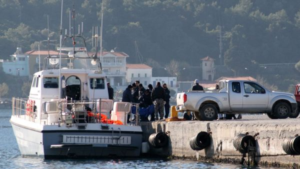 Coast guard vessel arrives with the dead bodies of migrants at the port of Vathi on the eastern Greek island of Samos on Thursday, Jan. 28, 2016. Authorities in Greece have raised the death toll from a migrant boat sinking to 18, after recovering seven