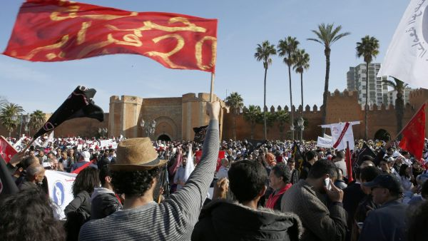 Anti-government protesters from the 20th February, the Moroccan Arab Spring movement, shout as thousands of teacher trainees march in Morocco's capital city, denouncing government measures that would trim the education branch of the public sector
