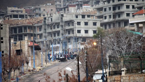 epa05101573 A general view for the besieged town of Madaya, in the countryside of Damascus, Syria, 14 January 2016. Convoys of humanitarian supplies, the second in a week, were on their way to three besieged Syrian towns. Some 44 trucks will enter the