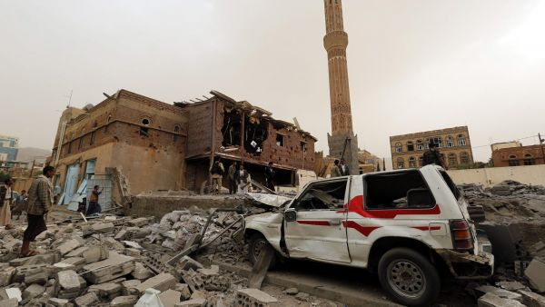 epa04849383 Yemenis inspect the damage caused to buildings and cars in airstrikes allegedly carried out by the Saudi-led coalition in Sana'a, Yemen, 16 July 2015. In late March, Saudi Arabia and fellow Sunni partners started an air campaign in Yemen