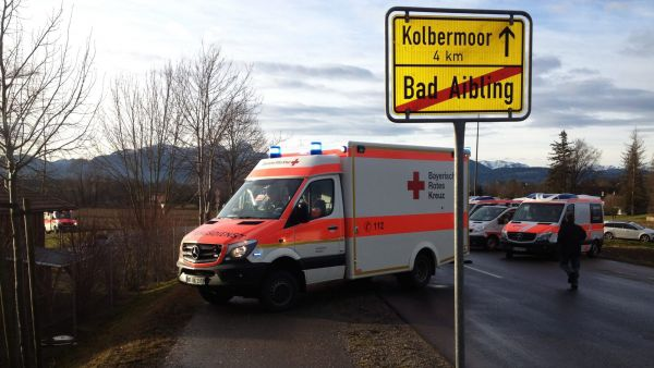 epa05150796 An ambulance next to an exit sign for Bad Aibling, Bavaria, near a train collision, Germany, 09 February 2016. At least two people died and another 100 were injured when two trains collided near the southern German town of Bad Aibling, police