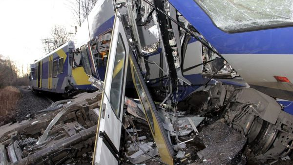 epa05150975 A damaged train following a collision near Bad Aibling, Germany, 09 February 2016. At least four people are dead and another 150 injured after two commuter trains collided head on near the southern German town of Bad Aibling, police said.  EPA