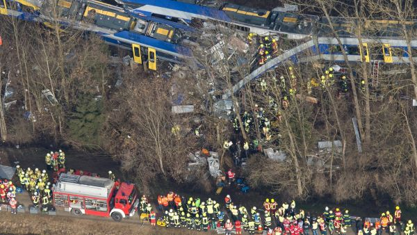 epa05151001 An aerial view of rescue forces working at the site of a train accident near Bad Aibling,Germany, 09 February 2016. At least eight people are dead and another 90 injured after two commuter trains collided head on near the southern German town