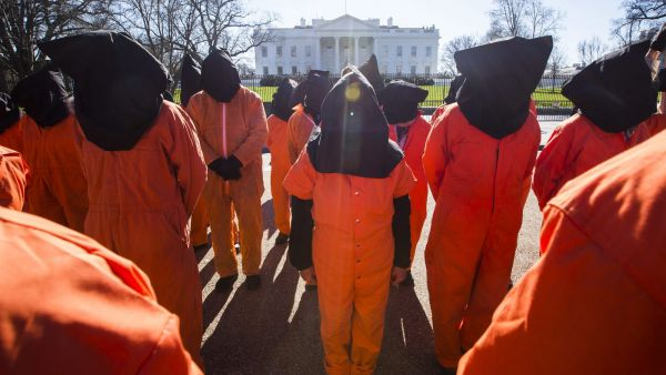 epa05097665 Supporters and members of the activist group 'The World Can't Wait' hold a rally and march asking for President Obama to close the U.S. detention camp at Guantanamo Bay, Cuba across from the White House in Washington, DC, USA,
