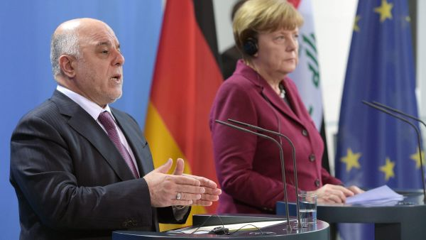 epa05154300 German Chancellor Angela Merkel (R) and Iraqi Prime Minister Haider al-Abadi speak during a press conference at the Chancellery in Berlin, Germany, 11 February 2016. Merkel and al-Abadi met for bilateral talks.  EPA/RAINER JENSEN