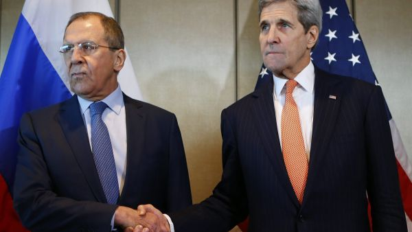 Russian Foreign Minister Sergey Lavrov, left, and U.S. Secretary of State John Kerry shake hands  prior to bilateral talks in Munich, Germany,  Thursday, Feb. 11, 2016. (AP Photo/Matthias Schrader)