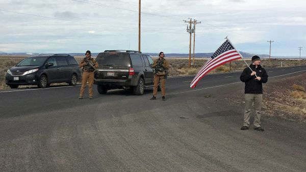 Armed law enforcement officers stand near a closed highway about 4 miles outside of the Malheur National Wildlife Refuge in Burns, Ore, after the last four occupiers of the national nature preserve surrendered on Thursday, Feb. 11, 2016. The holdouts were