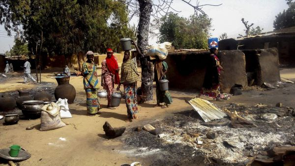 epa05149785 Nigerian women gather their belongings to depart the village of Mairi in the Konduga local government area of Borno State, North-East Nigeria following Boko Haram attacks over the weekend, Nigeria 08 February 2016. Three women and one man were