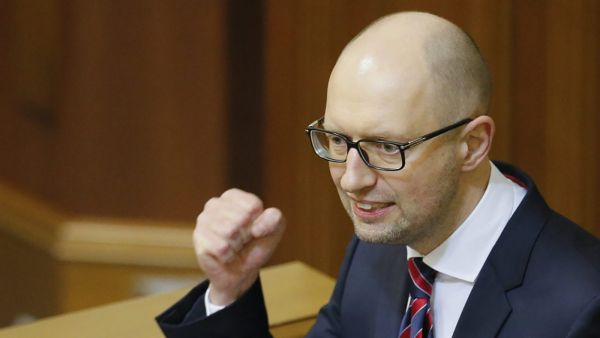epa05164660 Ukrainian Prime Minister Arseniy Yatsenyuk speaks to lawmakers during his annual report at Parliament in Kiev, Ukraine, 16 February 2016. Ukrainian President Petro Poroshenko asked Arseniy Yatsenyuk and General Prosecutor of Ukraine Viktor