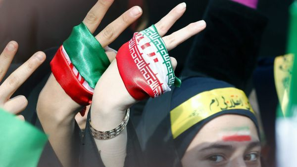 epa05154151 An Iranian student flashes a V for victory sign during a ceremony marking the 37th anniversary of the 1979 Islamic revolution, at the Azadi (Freedom) square in Tehran, Iran, 11 February 2016. The event mark the 35th anniversary of the Islamic