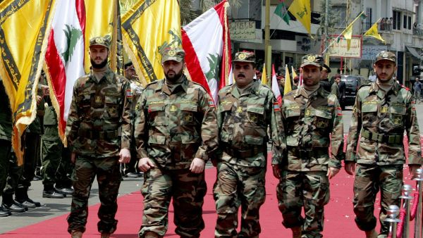 epa01416332 Freed Lebanese prisoner Samir Kuntar and his four freed comrades, wearing Hezbollah military fighters uniform, review guard of honour, during their visit at the tomb of slain Hezbollah commander Imad Maghnieh, in Beirut's southern suburbs