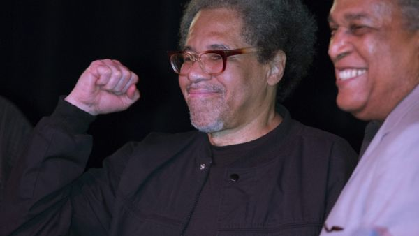 Albert Woodfox pumps his fist as he arrives on stage during his first public appearance at the Ashe Cultural Arts Center with Parnell Herbert, right, in New Orleans, Friday, Feb. 19, 2016 after his released from Louisiana State Penitentiary in Angola, La.