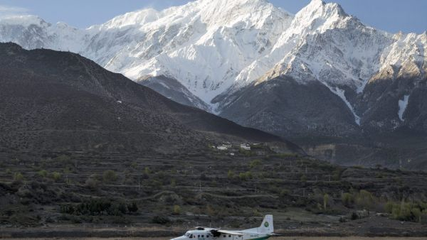 epa05177765 A picture made available on 24 February 2016 shows a twin aircraft of the Tara Airlines landing at Jomsom Airport, in Jomsom, a popular resort town west of Kathmandu, Nepal, 04 April 2015, as Mount Nilgiri is visible on the background.