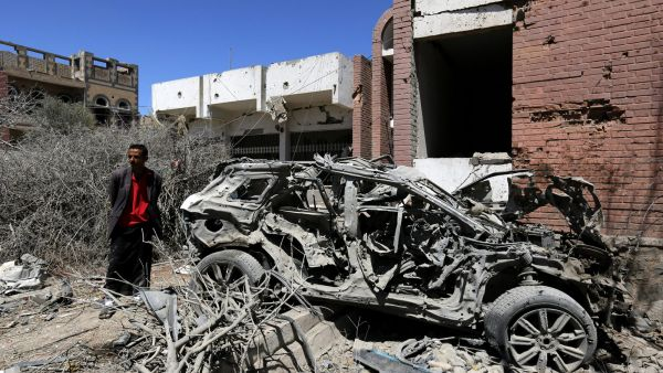 epa05183618 A Yemeni inspects the damage following a Saudi-led airstrike targeting a neighborhood in Sana'a, Yemen, 27 February 2016. According to reports, at least 40 people were killed in Saudi-led airstrikes hitting a market at the Nihem region,