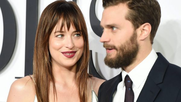 epa04616478 US actress Dakota Johnson (L) and Irish actor Jamie Dornan (R) pose for photographs on the red carpet at the UK film premiere of 'Fifty Shades of Grey in London, Britain, 12 February 2015. The movie opens in British theaters on 13