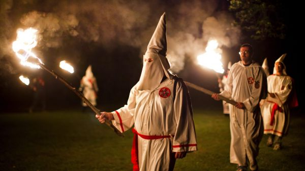 epa02942302 (20/25) Members of the Knights of the Southern Cross of the Ku Klux Klan (KSCKKK), joined by members of other Virginia Klan orders, hold a cross lighting ceremony on private property near Powhatan, Virginia, USA, 28 May 2011. The Invisible