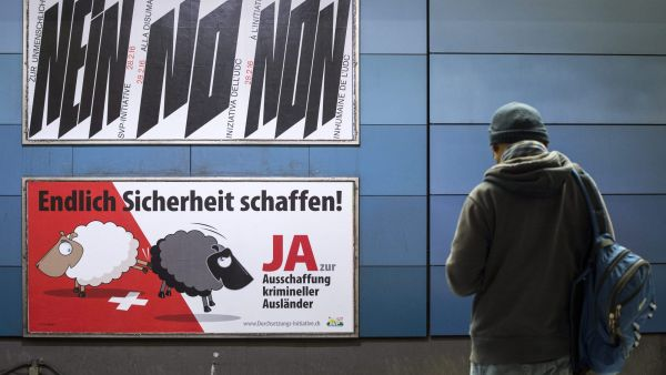 epa05184825 (FILE) A file photo dated 09 February 2016 of posters campaigning for (below) and against (up) the 'Enforcement Initiative' in Zurich , Switzerland. Swiss citizens are voting on 28 February 2016 on tougher rules for expelling
