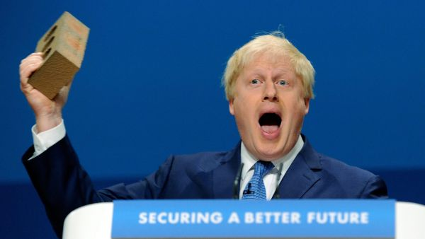 epa04424267 Mayor of London, Boris Johnson holds aloft a brick as he delivers a speech at the government Conservative Party Conference in Birmingham, central England 30 September 2014. In his speech he touched on the theme that the party is building homes