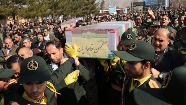epa05145758 Members of the Iranian Revolutionary Guard carry the coffins of Iran's Revolutionary Guard Brigadier General Mohsen Ghajarian and other Iranian 'volunteers', who were reportedly killed in the northern province of Aleppo in the