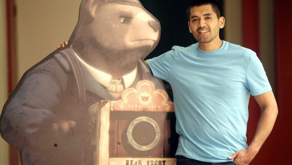 epa05123456 A photo made available on 24 January 2016 shows Chilean film director Gabriel Osorio posing next to a character of his animated short movie 'Bear Story' in Santiago de Chile, Chile, 21 January 2016. Bear Story was nominated for an