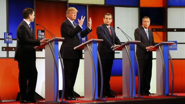 Republican presidential candidate, businessman Donald Trump, second from left, gestures as Sen. Marco Rubio, R-Fla., Sen. Ted Cruz, R-Texas, and Ohio Gov. John Kasich watch him a Republican presidential primary debate at Fox Theatre, Thursday, March 3,