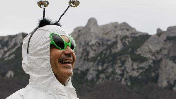 epa03515659 A man in fancy dress stands in the village of Bugarach, as authorities block access to the peak of Bugarach in Southern France, 21 December 2012. Bugarach is a small village of some 200 souls on the French side of the Pyrenees. New Agers and