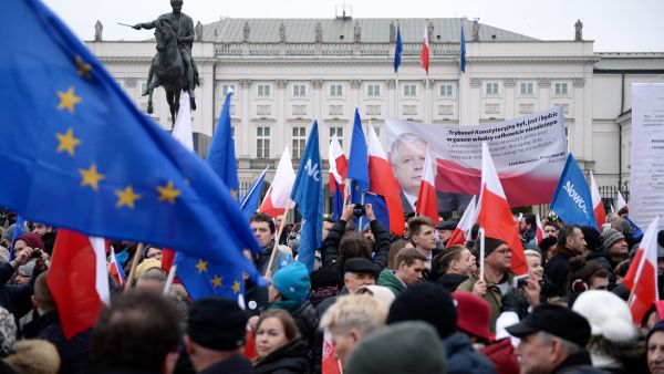 epa05207745 epa05207736 People take part in a demonstration organised by Modern, the Polish liberal political party (Nowoczesna) in front of the Constitutional Tribunal (TK) in Warsaw, Poland, 12 March 2016. Since coming into power in December 2015,