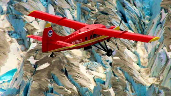 epa04409895 An undated handout picture made available by NASA on 21 September 2014 shows a DHC-3 Otter in NASA's Operation IceBridge-Alaska surveying mountain glaciers in Alaska, USA. NASA researchers carried out three Alaska-based airborne research