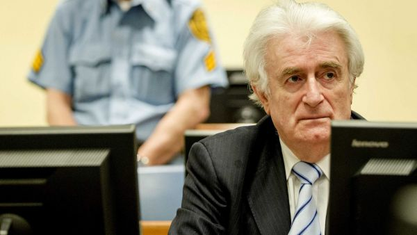 epa05228997 Bosnian Serb wartime leader Radovan Karadzic (R) sits in the courtroom for the reading of his verdict at the International Criminal Tribunal for Former Yugoslavia (ICTY) in The Hague, The Netherlands, 24 March 2016. The former Bosnian-Serbs