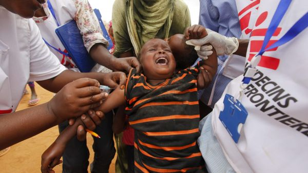 epa03792079 (FILE) A file photograph dated 01 August 2011 shows a Somali refugee boy crying as he receives a vaccination shot by Medecins Sans Frontieres (MSF) staff outside the Ifo camp, one of three camps that make up sprawling Dadaab refugee camp in