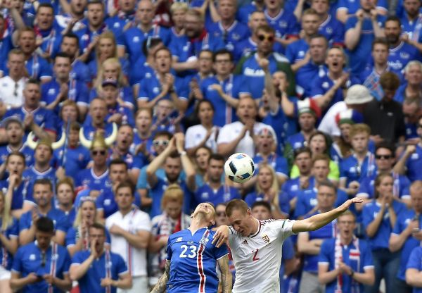 epa05376172 Ari Skulason (L) of Iceland and Adam Lang of Hungary in action during the UEFA EURO 2016 group F preliminary round match between Iceland and Hungary at Stade Velodrome in Marseille, France, 18 June 2016.