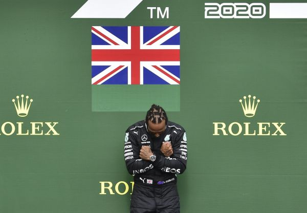 epa08635694 British Formula One driver Lewis Hamilton of Mercedes-AMG Petronas reacts on the podium  after winning the 2020 Formula One Grand Prix of Belgium at the Spa-Francorchamps race track in Stavelot, Belgium, 30 August 2020.  EPA-EFE/John Thys / Pool